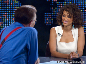 "Tyra Banks shows off her real hair during an appearance on ""Larry King Live."""
