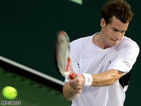 Murray strikes a backhand during his straight sets win over Blake in Abu Dhabi.