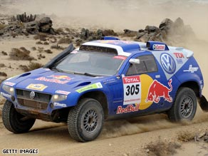 The Volkswagen of Giniel De Villiers won the 14th and final special stage to claim victory in the Dakar Rally.