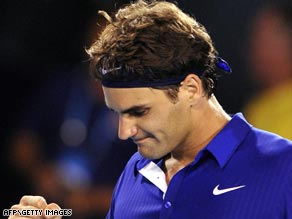 Roger Federer reacts after making a winning start to his bid for a record-equalling 14th Grand Slam crown.