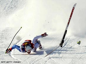 Albrecht nose-dives down Kitzbuehel's Streif course after crashing during training for a World Cup downhill.