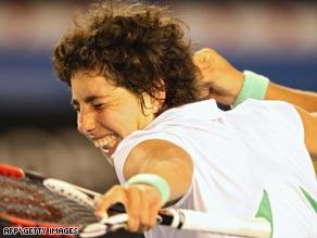Spain's Suarez Navarro celebrates her victory over sixth-seeded Venus Williams at the Australian Open.