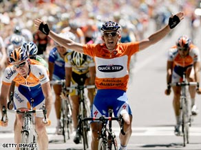Davis celebrates his second stage win to maintain his race lead in the Tour Down Under.