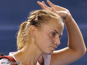 Shattered dreams: Dokic waves farewell to her Australian fans after failing to reach the semifinals in Melbourne.