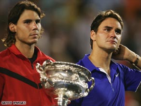 Nadal holds the trophy as an emotional Federer takes in his defeat.