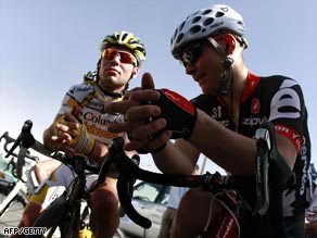Cavendish (left) shares a moment with fellow Briton Roger Hammond before the start of the stage.