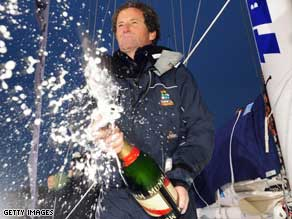 Celebration time: Michel Desjoyeaux sprays champagne after winning the Vendee Globe race.