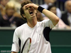 Murray agonizes over a missed point on his way into the second round of the Rotterdam Open.