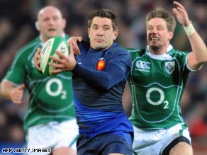 France's Florian Fritz, center, has been banned for three weeks after being found guilty of striking an opponent.