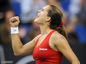 A fired up Mauresmo celebrates her victory over Jankovic.