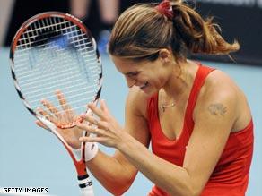 Mauresmo cannot hide her joy after beating Elena Dementieva in the Paris Open final.