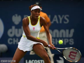 Venus powers a backhand during her straight sets win over Cornet in Dubai.