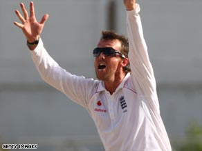 England spinner Graeme Swann claims the wicket of Brendan Nash but the Antiguan Test ended in a draw.