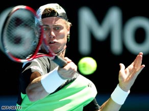 Hewitt eased past Guccione to earn a quarterfinal berth against Rochus in Memphis.