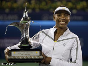 Venus Williams shows off the impressive Dubai Open trophy, the 40th title of her impressive career.