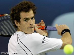 Murray showed signs of an ankle problem as he moved into second round of the Dubai tournament.