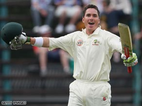 Marcus North celebrates scoring a century on his debut as Australia cemented their grip on the opening Test.