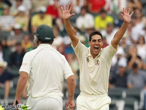 Johnson celebrates the wicket of Boucher on the third day at the Wanderers.