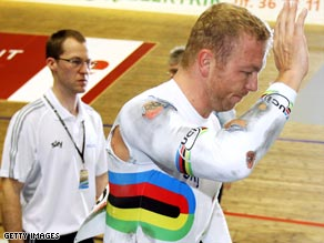 Olympic champion Hoy has waved goodbye to his world medal hopes following, above, his crash in Copenhagen.
