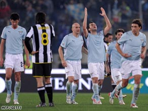 Pandev raises his hands after scoring Lazio's equalizer in the Stadio Olimpico.