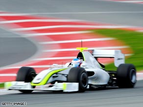 Button puts the new Brawn GP car through its paces in Barcelona.