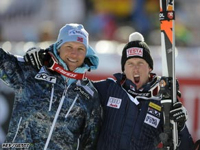 Svindal (left) and Heel celebrate their success in Thursday's super-G race.