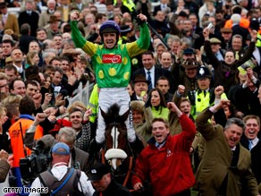 Walsh and Kauto Star returned to the paddock at Cheltenham to a tumultous reception.