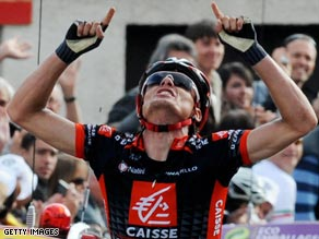 Sanchez celebrates Saturday's stage win, taking the race leader's yellow jersey in the process.