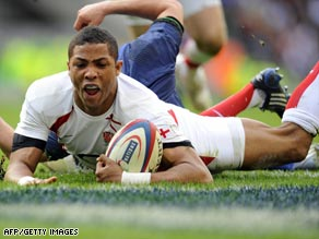 Delon Armitage crosses the line for England as they overwhelmed France 34-10 at Twickenham.