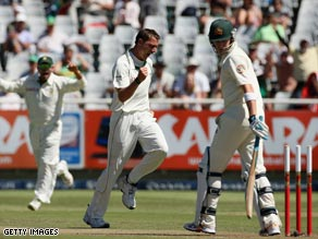 Dale Steyn celebrates the wicket of Mike Hussey as South Africa took early control of the third Test.