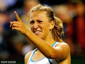 Azarenka signals to her coach after completing her victory over top seed Safina.