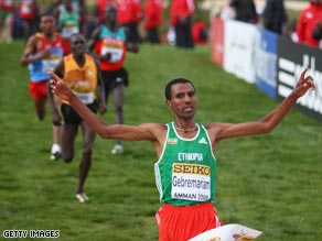 Gebremariam crosses the line first to claim gold in the world cross country championships.