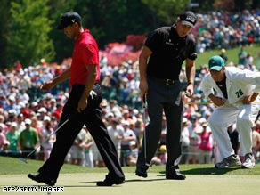 Tiger Woods and Phil Mickelson are shown on the sixth hole during Sunday's final round of play at the Masters.