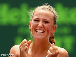 Azarenka shows her delight after beating Serena in the final at Key Biscayne.