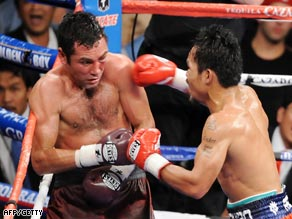 De La Hoya (left) was stopped in the eighth round by Manny Pacquiao in Las Vegas.