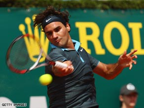 Federer powers a forehand during his straight sets win of Andrea Seppi in Monte Carlo