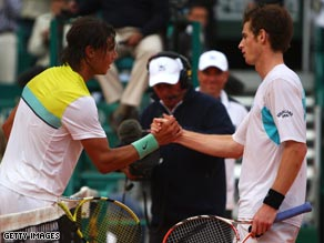 Nadal (left) shakes hands with Murray at the conclusion of their semifinal.