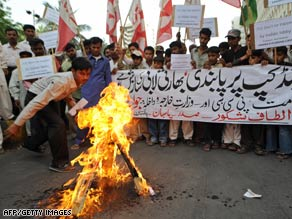 Pakistanis in Karachi  burn cricket bats in protest against the International Cricket Council (ICC) on Saturday.