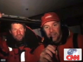 Jerry Kirby (l) and Ken Read (r) speak with CNN from aboard the Puma Racing Volvo Ocean Race boat