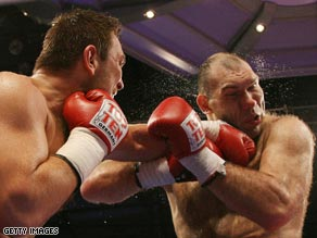 Ruslan Chagaev (left) lands a powerful left-hander during his win over Nikolai Valuev two years ago.