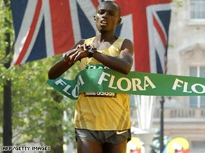 Wanjiru crosses the line in a personal best time to add the London Marathon title to his Olympic victory.