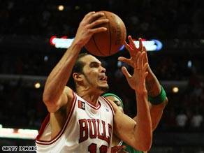 Noah goes up for a dunk with Paul Pierce challenging.