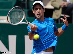 Djokovic powers a forehand during his easy victory over del Potro.