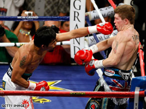 Manny Pacquiao throws a left hand on his way to a devastating victory over Ricky Hatton.