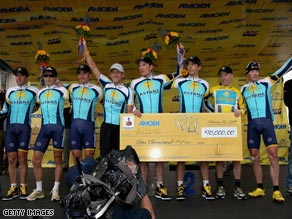 Armstrong (fourth left) and his team-mates could be riding for a new sponsor if the team's money problems continue.