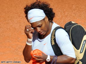 Serena Williams slips away after quitting her first round match at the Madrid Open through injury.