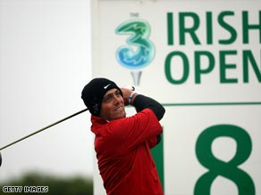 Molinari matched his lowest-ever European Tour round with a course record 63 to lead the Irish Open.