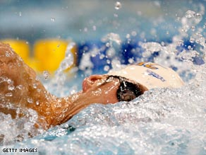 Phelps qualified for the 200m freestyle final on his return to action after a three-month ban.
