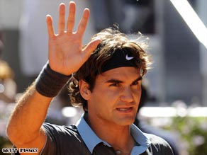 Federer acknowledges the crowd after stunning Rafael Nadal in straight sets in the Madrid Masters final.