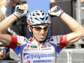 Bertagnolli celebrates finishing alone to win Sunday's 15th stage of the Giro d'Italia.